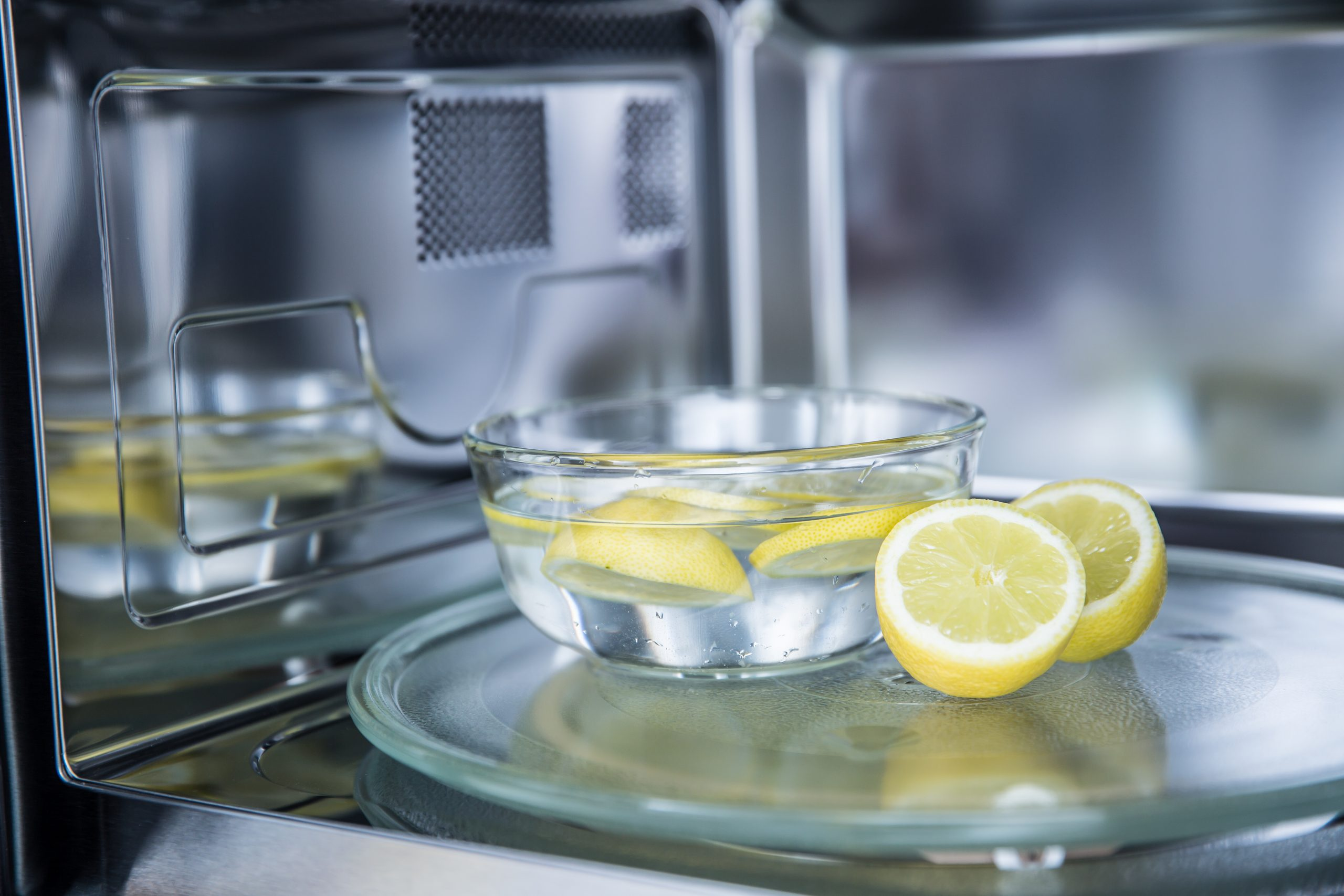 How to clean a microwave: Including a bit of lemon can add a hint of freshness to your vinegar solution!